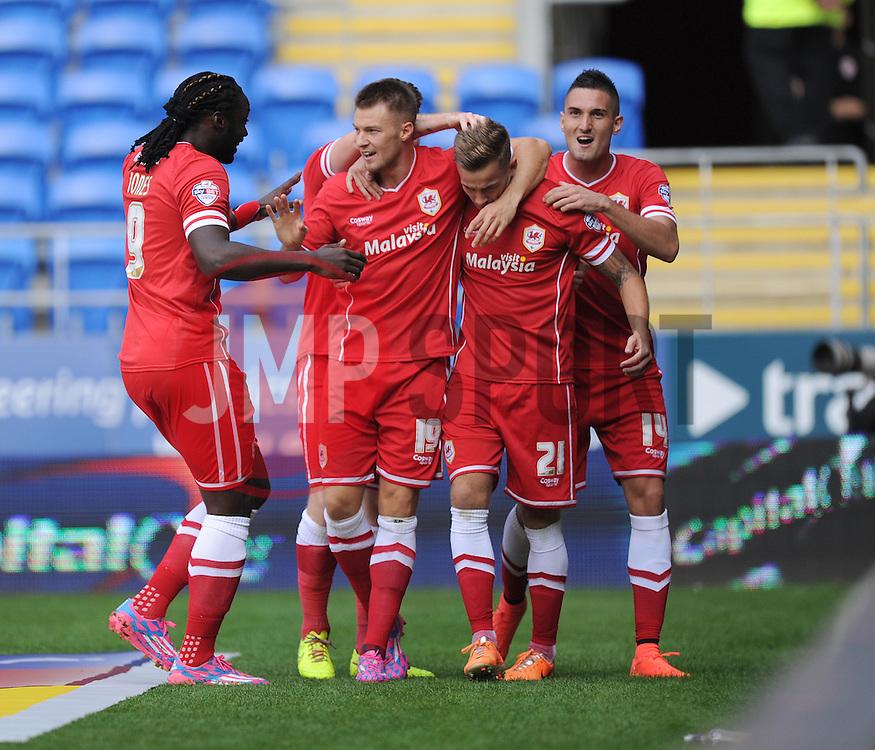 Cardiff City's Joe Ralls celebrates with team. - Photo mandatory by-line: Alex James/JMP - Mobile: 07966 386802 30/08/2014 - SPORT - FOOTBALL - Cardiff - Cardiff City stadium - Cardiff City  v Norwich City - Barclays Premier League