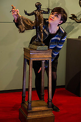Pictured: Hannah Willetts, a Lyon and Turnbull specialist, was on hand to ensure the sculpture was looking it's best ahead of the auction.<br /> <br /> A model of Sir George Frampton's bronze sculpture of J.M. Barrie's Peter Pan,  valued between £20,000 and £30,000 , will go up for auction by Lyon and Turnbull, Edinburgh, on 6 April.<br /> <br /> Ger Harley   EEm 3 April 2016