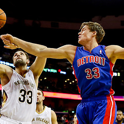 Dec 11, 2013; New Orleans, LA, USA; New Orleans Pelicans power forward Ryan Anderson (33) and Detroit Pistons power forward Jonas Jerebko (33) battle for the ball during the second quarter at New Orleans Arena. Mandatory Credit: Derick E. Hingle-USA TODAY Sports