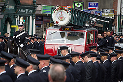 © Licensed to London News Pictures . 02/09/2013 . Bury , UK . Stephen Hunt's coffin was delivered to the church on board on vintage fire engine , lead by mounted police in full dress uniform . The funeral of fireman Stephen Hunt at Bury Parish Church today (Tuesday 3rd September 2013) . Stephen Hunt died whilst tackling a blaze at Paul's Hair World in Manchester City Centre in July 2013 . Photo credit : Joel Goodman/LNP