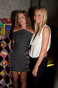 NATALIA VODIANOVA; GWYNETH PALTROW, Vogue: Fashion's Night Out: Stella McCartney. Stella McCartney, 30 Bruton Street, London. 8 September 2010.  -DO NOT ARCHIVE-© Copyright Photograph by Dafydd Jones. 248 Clapham Rd. London SW9 0PZ. Tel 0207 820 0771. www.dafjones.com.