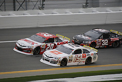 February 9, 2019 - Daytona, FL, U.S. - DAYTONA, FL - FEBRUARY 09: Harrison Burton (20) DEX Imaging Toyota, Christian Eckes (15) JBL Audio Toyota,Gus Dean (32) CAB Installers-BakerDist-LGHVAC Chevrolet during the running of the Lucas Oil 200 on February 9, 2019 at Daytona International Speedway in Daytona Beach, Florida (Photo by Jeff Robinson/Icon Sportswire) (Credit Image: © Jeff Robinson/Icon SMI via ZUMA Press)