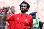 Liverpool striker Mohamed Salah (11) waves at the crowd during the Manchester United and Liverpool International Champions Cup match at the Michigan Stadium, Ann Arbor, United States on 28 July 2018.