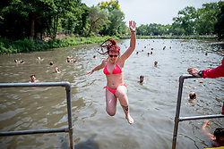 © Licensed to London News Pictures. 01/07/2018. London, UK. Louise Marshall swims in Hampstead Heath Mixed Bathing Pond in north London on Sunday, July 1, 2018 as heatwave has reached 31C and is set to continue into the next week and the unusually high temperatures look set to remain until the week after next. Photo credit: Tolga Akmen/LNP