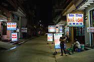Billboards for local cheap  guesthouses called Nha Nghi, Lang Son, Vietnam, Southeast Asia