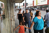 Families shop on the streets of downtown Brownsville, TX on April 23, 2010. Brownsville is a border town with Matamoros, Mexico. The region is a conduit for drugs moving north into the US and drug proceeds and weapons moving south from Texas into Mexico. (Photo/Scott Dalton)