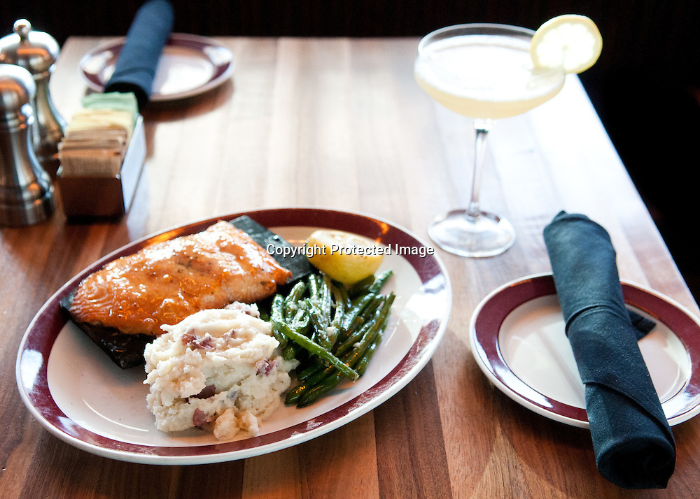 The Plank Salmon served with a Beez Knees cocktail at Founding Farmers in Washington DC. Photo by Kris Connor