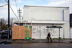 23 February 2014. New Orleans, Louisiana.<br /> Scene of the crime. The building where thieves attempted to chop a Banksy original painting from the wall of an old abandoned store in New Orleans on the corner of North Rampart and Kerlerec street. The building will be guarded 24 hours a day for the time being.<br /> Photo; Charlie Varley/varleypix.com
