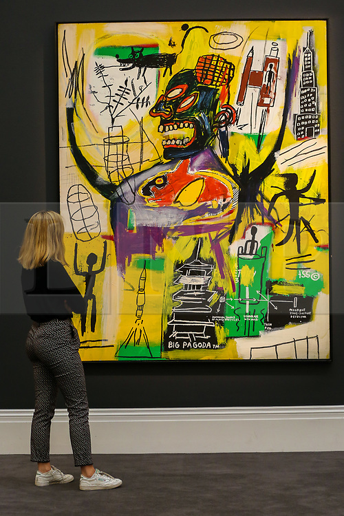 "© Licensed to London News Pictures. 27/09/2019. London, UK. A staff member view Jean-Michel Basquiat's artwork titled ""Pyro"" during the preview of Sotheby's Frieze Week Contemporary Art Sale. The auction will take place on 3rd October 2019.  Photo credit: Dinendra Haria/LNP"