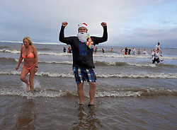 New Year revellers take a dip in the Firth of Forth at Portobello.