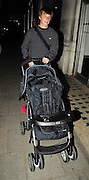 09.MAY.2009 LONDON                                                  <br /> <br /> ARSENAL AND RUSSIAN FOOTBALLER ANDREI ARSHARVIN WALKING DOWN PARK LANE AT 10.45PM PUSHING AN EMPTY BUGGY THE NIGHT BEFORE ARSENAL'S GAME AGAINST RIVALS CHELSEA.<br /> <br /> BYLINE MUST READ EDBIMAGEARCHIVE.COM<br /> <br /> *THIS IMAGE IS STRICTLY FOR UK NEWSPAPERS & MAGAZINES ONLY* <br /> *FOR WORLDWIDE SALES & WEB USE PLEASE CONTACT EDBIMAGEARCHIVE-0208 954 5968*