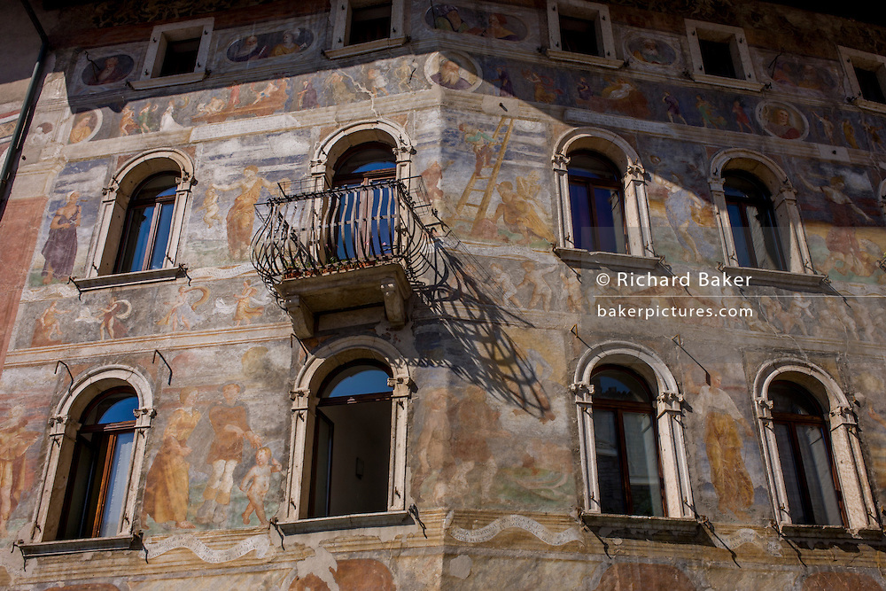 Fresco facades on historic buildings in Piazza Duomo, Trento.