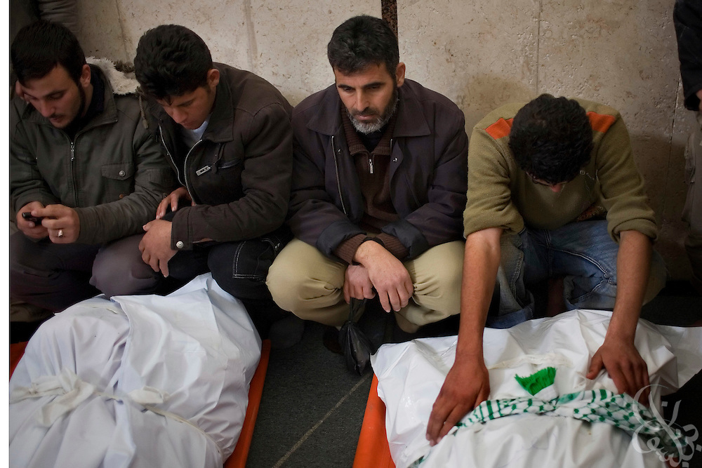 Relatives and friends mourn over the bodies of four HAMAS men killed during the recently ended military operation by the Israelis against HAMAS at a January 19, 2009 funeral in the Jabaliya Camp in the Gaza Strip. During the 21 day operation , Israel specifically targeted members of the HAMAS forces and  heavily damaged the groups infrastructure.