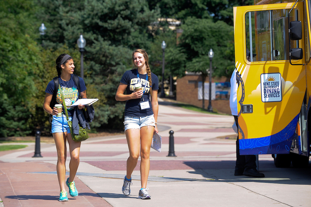 Two students in the Destination Kent State program walk back to the student center after getting coffee from the Fork in the Road dining truck.