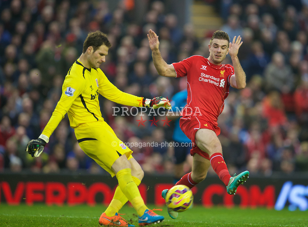 LIVERPOOL, ENGLAND - Saturday, November 29, 2014: Liverpool's Jordan Henderson in action against Stoke City's goalkeeper Asmir Begovic during the Premier League match at Anfield. (Pic by David Rawcliffe/Propaganda)