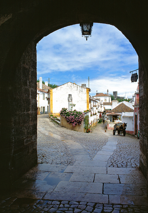 An archway frames this quaint picture in Obidos National Monument, Portugal.