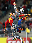 SERGIO RAMOS challenges Diego BENAGLIO  during the 2010 FIFA World Cup South Africa Group H match between Spain and Switzerland at Durban Stadium on June 16, 2010 in Durban, South Africa.