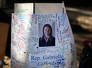 A sign is seen at the memorial outside the offices of congresswoman Gabrielle Giffords in Tucson, Arizona January 11, 2011. REUTERS/Rick Wilking (UNITED STATES)