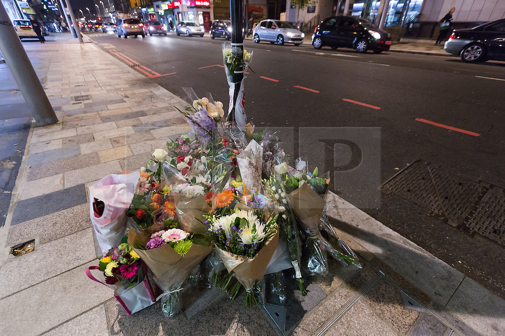 © Licensed to London News Pictures. 31/10/2016. LONDON, UK.  Flowers and tributes to cyclist, Lucia Ciccioli are placed on Lavendar Hill where she was killed. The campaign group, 'Stop Killing Cyclists' held a die in protest at the spot where she died following a collision with a Heavy Goods Vehicle (HGV) lorry one week ago. Cycling groups and their supporters are calling for the Mayor of London, Sadiq Khan to ban HGV's from the capital.  Photo credit: Vickie Flores/LNP