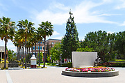 Charles Chapman Statue with Leatherby Libraries in the Background on Campus of Chapman University