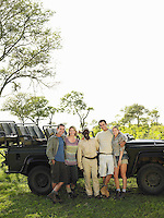 Group portrait of four tourists and safari guide