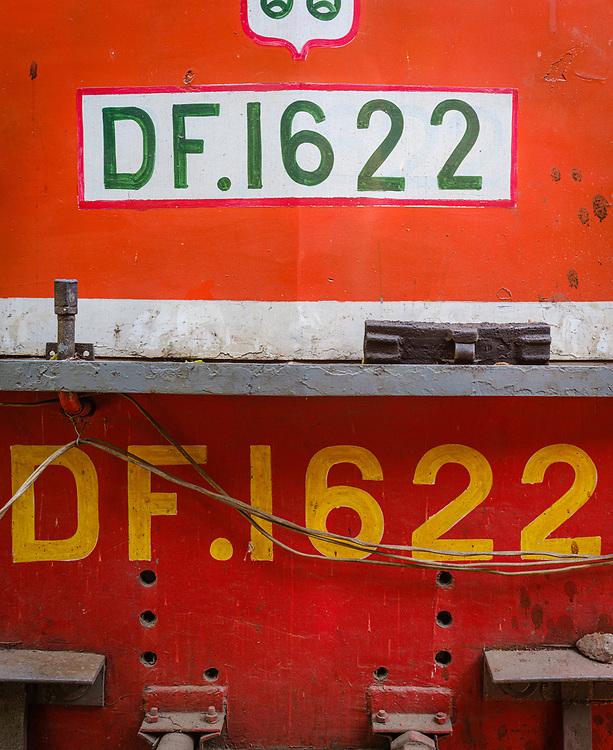 YANGON, MYANMAR - CIRCA DECEMBER 2017: Close up photo of train motor locomotive from the Yangon Circular Railway