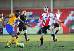 Carl Winchester of Cheltenham Town chases down Hayden White of Mansfield Town - Mandatory by-line: Nizaam Jones/JMP- 04/03/2017 - FOOTBALL - LCI Rail Stadium - Cheltenham, England - Cheltenham Town v Mansfield Town -Sky Bet League Two