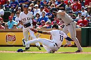 March 29, 2018 - Arlington, TX, U.S. - ARLINGTON, TX - MARCH 29: Texas Rangers first baseman Joey Gallo (13) is on the ground after being knocked over by Texas Rangers starting pitcher Cole Hamels (35) as Houston Astros catcher Brian McCann (16) tries to avoid the tag during the game between the Texas Rangers and the Houston Astros on March 29, 2018 at Globe Life Park in Arlington, Texas. Houston defeats Texas 4-1. (Photo by Matthew Pearce/Icon Sportswire) (Credit Image: © Matthew Pearce/Icon SMI via ZUMA Press)