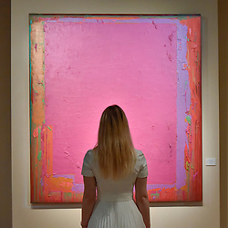 "© Licensed to London News Pictures. 28/06/2017. London, UK.  A visitor views ""20.5.74"" by John Hoyland.  Preview day at Masterpiece London, a leading art fair held in Chelsea, bringing together 150 international exhibitors presenting works from antiquity to the present day.  The event runs 29 June to 5 July 2017.   Photo credit : Stephen Chung/LNP"