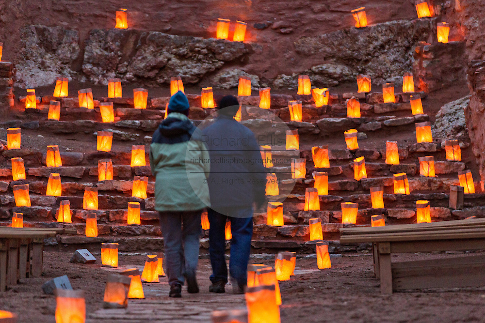 People view the ruins of the San José de los Jémez Mission part of the Jemez Historic Site illuminated by hundreds of small paper lanterns known as luminaria to celebrate the holiday season December 12, 2015 in Jemez Springs, New Mexico. The site is in the Jémez Indian pueblo and contains an early 17th-century mission complex.