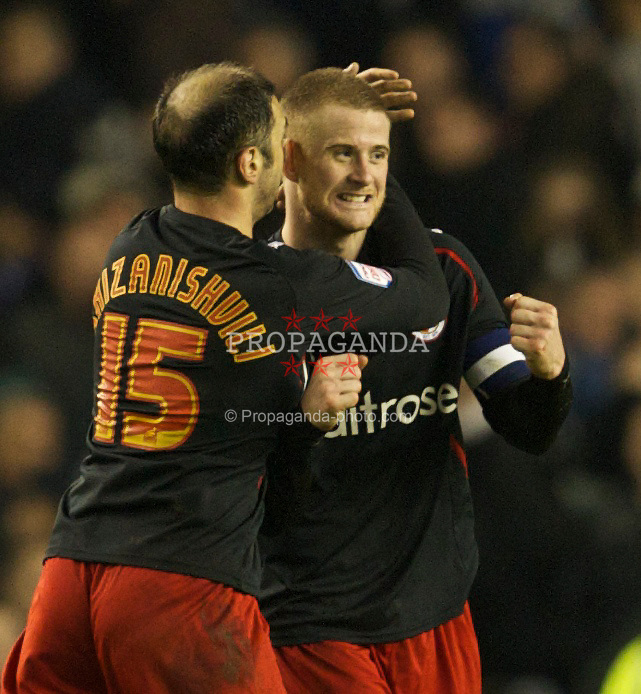 LIVERPOOL, ENGLAND - Tuesday, March 1, 2011: Reading's match-winner goalscorer Matt Mills celebrates his side's 1-0 victory over Everton during the FA Cup 5th Round match at Goodison Park. (Photo by David Rawcliffe/Propaganda)