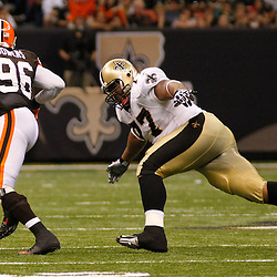 Oct 24, 2010; New Orleans, LA, USA; Cleveland Browns linebacker David Bowens (96) avoids New Orleans Saints guard Carl Nicks (77) on a interception return for a touchdown during the second half at the Louisiana Superdome. The Browns defeated the Saints 30-17.  Mandatory Credit: Derick E. Hingle