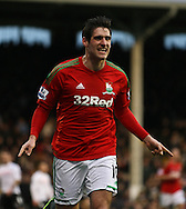 Picture by David Horn/Focus Images Ltd +44 7545 970036.29/12/2012.Danny Graham of Swansea City celebrates scoring the opening goal during the Barclays Premier League match at Craven Cottage, London.