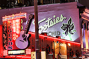 Signs for Tootsies, Legends and other honky-tonks on lower Broadway in Nashville, TN.