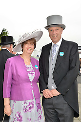 CHRIS GRAYLING MP and his wife SUSAN at the Investec Derby at Epsom Racecourse, Epsom, Surrey on 4th June 2016.