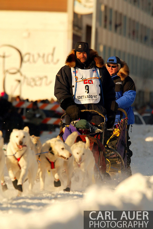 3/3/2007:  Anchorage Alaska -  Veteran Jim Lanier of Chugiak, AK heads down 4th Avenue in Anchorage for the start of the 35th Iditarod Sled Dog Race