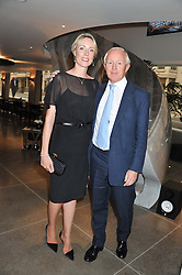 SIMON BREWER and his wife REBECCA at the opening of the new St.James Theatre, 12 Palace Street, London SW1 on 13th September 2012.