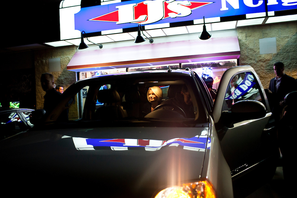 Callista Gingrich, wife of Republican presidential candidate Newt Gingrich, sits in an SUV after joining her husband at a campaign stop at LJ's Neighborhood Bar & Grill on Sunday, January 1, 2012 in Waterloo, IA.
