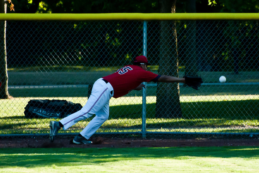 Lathan Goumas for the Midland Daily News..Joel Melendez of the USA Junior attempts a diving catch during a game against the Midland Junior Explorers Fastpitch Softball team at Currie Stadium in Emerson Park in Midland, Mich. on Friday, July 20, 2012.