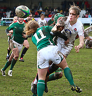Esher, Surrey, Sunday February 28th 2010: England's Emily Scarratt is tackled by Amy Davis (11) of Ireland during the Ladies Six Nations match between England and Ireland at Esher Rugby Club. (Pic by Andrew Tobin/Focus Images)
