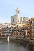 Cathedral de Santa Maria overlooking the river Onyer (Onyar) in the ancient walled city of Girona, (Gerona) Spain.