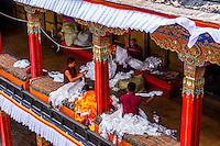 Buddhist monks sorting khatas (traditional ceremonial scarfs), Tashilhunpo Monastery, Shigatse, Tibet (Xizang), China.