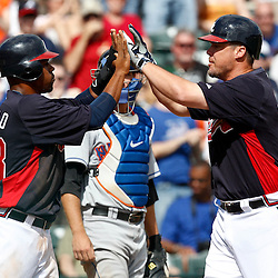 March 5, 2011; Lake Buena Vista, FL, USA; Atlanta Braves third baseman Chipper Jones (10) celebrates with catcher Wilkin Castillo (53) after hitting a homerun during a spring training exhibition game against the New York Mets at Disney Wide World of Sports complex.  Mandatory Credit: Derick E. Hingle