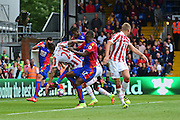 Stoke defender Geoff Cameron (20) in a goalmouth bundle with Crystal Palace forward Cbristian Benteke (17) during the Premier League match between Crystal Palace and Stoke City at Selhurst Park, London, England on 18 September 2016. Photo by Jon Bromley.