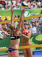 STARE JABLONKI POLAND - July 6: Britta Buthe of Germany and Whitney Pavlik of USA in action during Day 6 of the FIVB Beach Volleyball World Championships on July 6, 2013 in Stare Jablonki Poland.  (Photo by Piotr Hawalej)