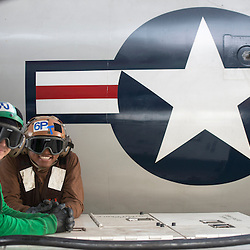 USS John C Stennis CVN-74 Aircraft Carrier.Pic Shows Flight and Hangar Deck personnel making sure the  aircraft are ready for take off