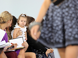 Harper Seven sits  on Victoria Beckham's  lap as she watches her mothers Victoria show  at  New York Fashion Week, Tuesday September 11, 2012. Photo by: Stephen Lock / i-Images. EXCLUSIVE SET OF PICS  USAGE FEE APPLIES. Contact Andrew Parsons  on 07545 311662.£500 minimum fee for use?Contact agency for fees before use.One use only repro fees apply..Mandatory Credit Stephen Lock/i-Images .Permission By Victoria Beckham has been given to use these pictures