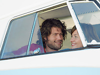 Young couple smiling at each other in van head and shoulders