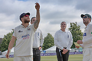 Chris Dent spins the coin at the toss before the Specsavers County Champ Div 2 match between Gloucestershire County Cricket Club and Leicestershire County Cricket Club at the Cheltenham College Ground, Cheltenham, United Kingdom on 15 July 2019.