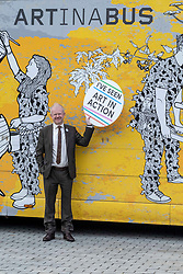 Pictured: John Mason, MSP,  Scottish National Party Member of the Scottish Parliament for Glasgow Shettleston, took time out to engage with culture on his work doorstep.<br /><br />The Travelling Gallery bus was to be found outside the Scottish Parliament today as part of the national Art in Action campaign. <br /><br />Ger Harley | EEm 1 Octobere 2019